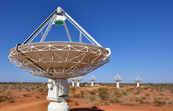 Close up of a radio astronomy telescope with several more in... [ID:2161]