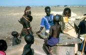 Villages at communal well in Kenya, Africa. 1981.