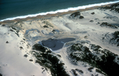 Waste disposal ponds in coastal sand dunes near Bunbury, WA. 1983.