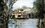 Paddlesteamer 'Emmylou' on a pleasure cruise down the Murray River, steaming past the old wharf at Echuca, VIC.