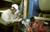 Dr Michael Wendt taking measurements during a test run of the Liquatech prototype furnace