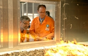 Senator Kim Carr and Andrew Sullivan of CSIRO Sustainable Ecosystems inspecting the Pyrotron