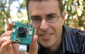 Dr Tim Wark and one of the hundred or so static sensor nodes that will process video and audio data so virtual visitors to Sweden's Lycksele Zoo can see what the animals see