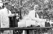 Drs George Rogers and Bruce Fraser performing chemical tricks for the Parkville laboratory Christmas party