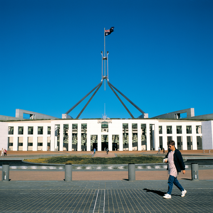 Australian flag flying above Parliament House in the nations...