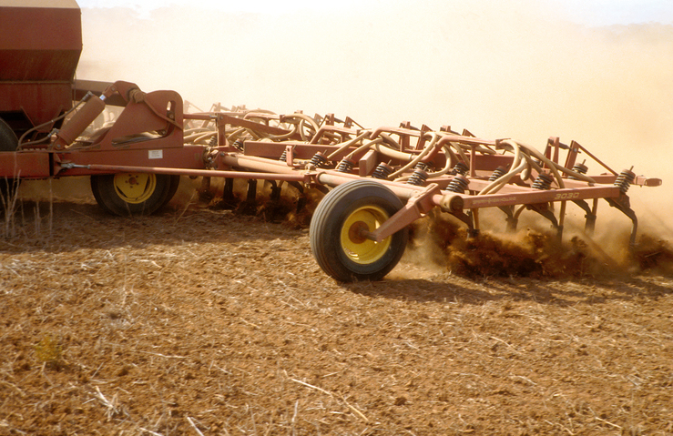 Agricultural seeding equipment in operation at Long Plains, ...