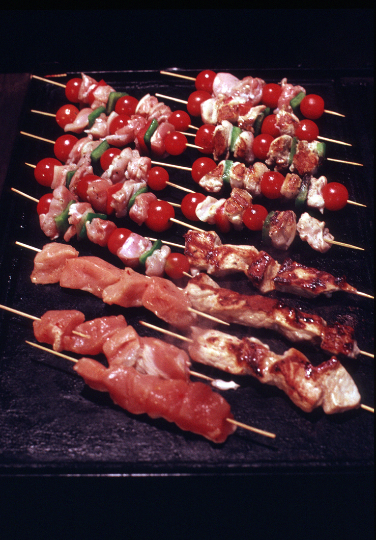Chicken kebabs on the BBQ.