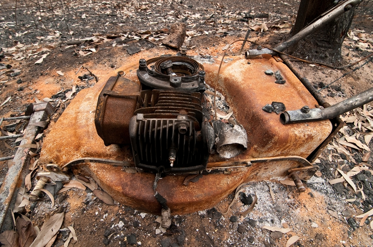 A lawnmower destroyed by fire at Kinglake after the 'Black S...
