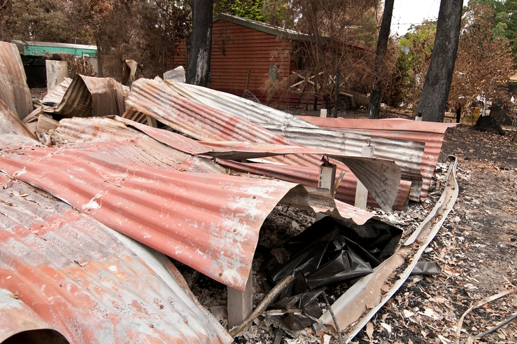 Buckled roof panels from a destroyed building at Kinglake af...