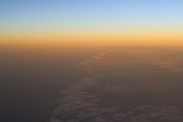 Sunrise from the air over Bass Strait at dawn.