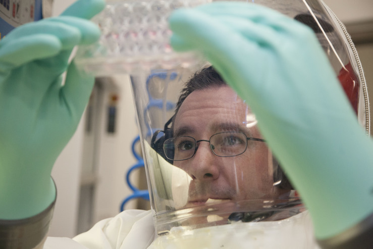 CSIRO scientist working at the highest level of biosecurity