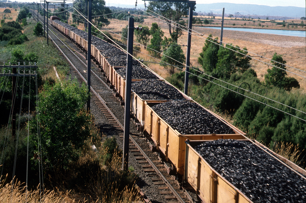 Freight Train Loaded With Coal Briquettes