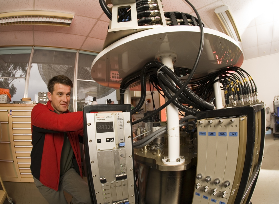 A receiver technician works on the methanol multibeam receiv...