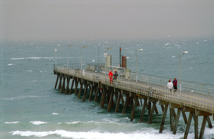 Fishermen brave the stormy conditions on the Glenelg Jetty on the Adelaide coastline, SA. 1995.