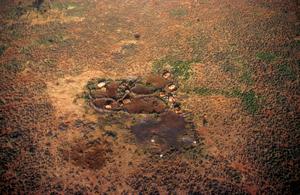 Village on the Manyatta El Bata Plains in Kenya, Africa. 1981.