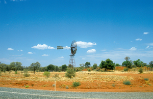 Windmill beside the Stuart Highway, north of Alice Springs in the Northern Territory. 1992.