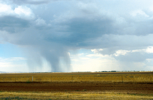 Rainfall on the plains near Balaklava, South Australia. Mt Lofty Ranges can be seen in the left background. 1992.