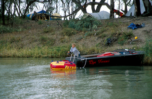 Young fisherman trying his luck at a campsite on the Murray River, downstream from Blanchetown, SA. 2006.