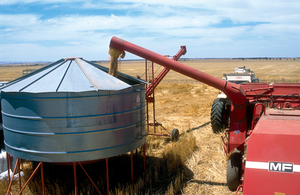 Harvesting equipment in operation near Blyth in the mid north of South Australia. 1986.