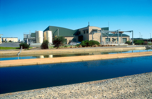 Channels bring effluent water from stabilization lagoons to the Bolivar Recycled Water complex for purification treatment. The recycled water will be used for irrigation on market gardens at nearby Virginia, north of Adelaide, SA. 2002.