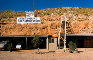 The Look-Out Cave provides underground accommodation in abandoned opal mines at Coober Pedy, SA. Many miners still live in dug-outs underground to avoid the sweltering heat of summer in Australians inland deserts. 1989.