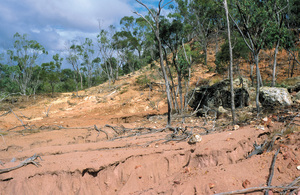Dryland salinity has induced serious hillslope gully and sheet erosion at base of Mesa landscape just west of Charters Towers, Northern QLD.