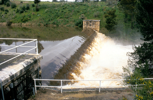 Flood waters surge over the Clarendon Weir in the Adelaide Hills, South Australia. 1992.