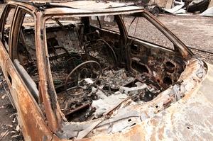 A burnt-out car at Kinglake after the 'Black Saturday' bushfires
