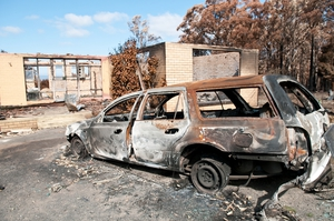 A burnt-out car and house at Kinglake after the 'Black Saturday' bushfires