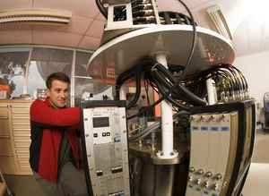 A receiver technician works on the methanol multibeam receiver package at the CSIRO Parkes radio telescope