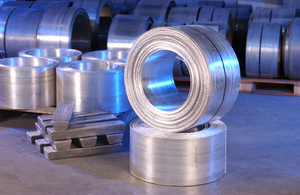 Coiled magnesium sheets and magnesium ingots.