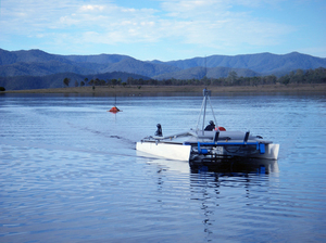 CSIRO's autonomous, solar-powered catamaran on Lake Wivenhoe travels between floating nodes gathering data.