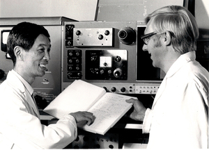 Prof Tao and Bob Blagrove discussing results of experiments on Spinco model E ultracentrifuge