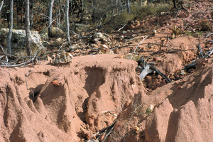 Hillslope gully and sheet erosion at base of Mesa landscape just west of Charters Towers, Northern QLD.