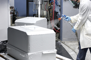 CSIRO researcher applying coating to carbon anode