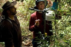 CSIRO ICT scientist Darren Moore (right) and former CSIRO scientist Glenn Foley with a sensor node used for monitoring conditions ripe for rainforest rehabilitation